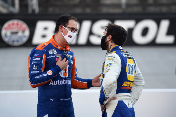 Joey Logano, Team Penske Ford Autotrader talks with Chase Elliott, Hendrick Motorsports Chevrolet NAPA Auto Parts, after the race, Copyright: Jared C. Tilton/Getty Images.
