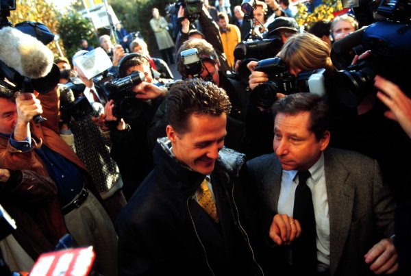 FIA Hearing, RAC MSA, Colnbrook, Berkshire, Great Britain.11 November 1997.Michael Schumacher and Jean Todt of Ferrari arrive at the RAC MSA Headquarters in Colnbrook for Schumacher's hearing into his driving at the European Grand Prix at Jerez in which he clashed with Jacques Villeneuve.World - LAT Photographic
