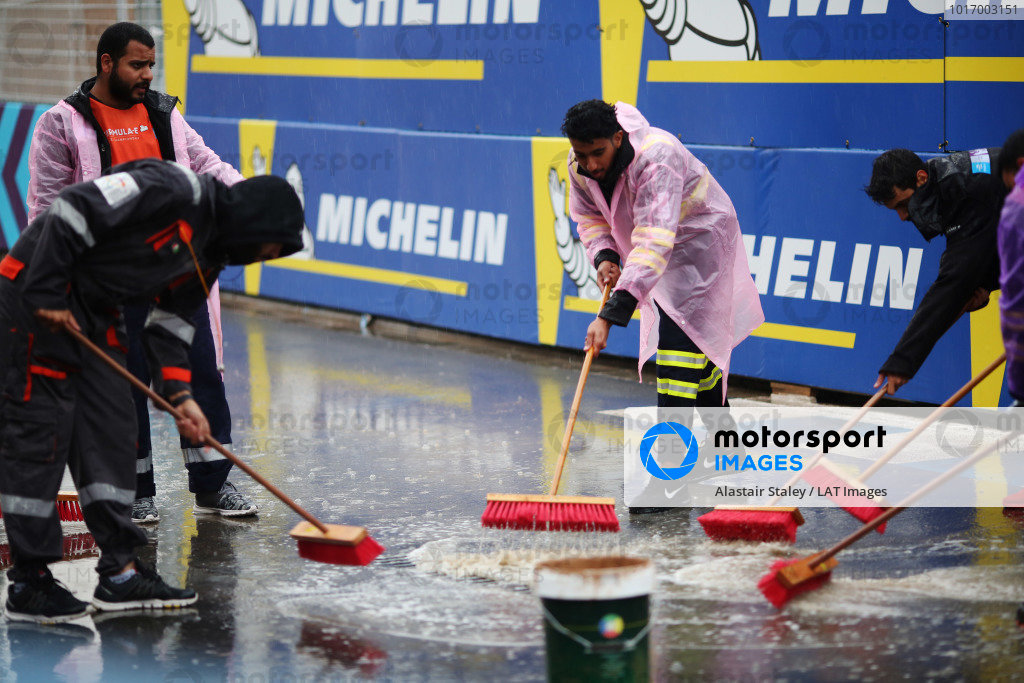 Marshals try to dry the track