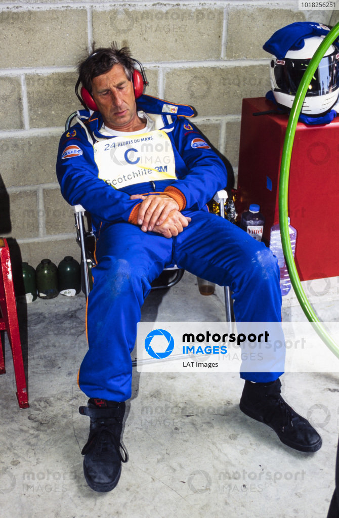 A mechanic catches a few moments rest during the race.