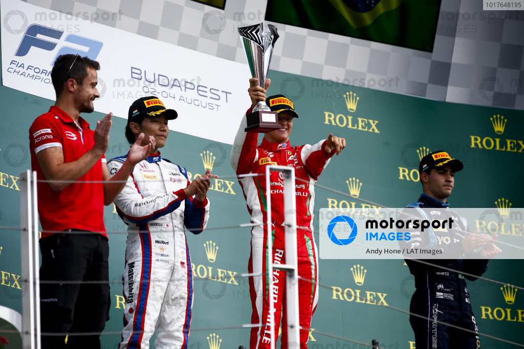 HUNGARORING, HUNGARY - AUGUST 04: Nobuharu Matsushita (JPN, CARLIN), Race winner Mick Schumacher (DEU, PREMA RACING) and Sergio Sette Camara (BRA, DAMS) celebrate on the podium during the Hungaroring at Hungaroring on August 04, 2019 in Hungaroring, Hungary. (Photo by Andy Hone / LAT Images / FIA F2 Championship)