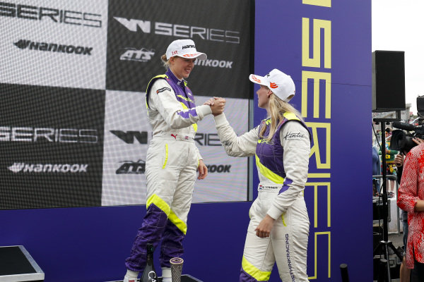 Alice Powell (GBR) and Beitske Visser (NLD) celebrate on the podium