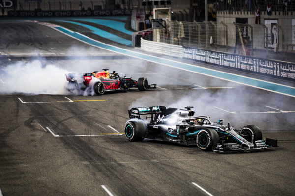 Max Verstappen, Red Bull Racing RB15, 2nd position, and Lewis Hamilton, Mercedes AMG F1 W10, 1st position, perform donuts in celebration at the end of the race