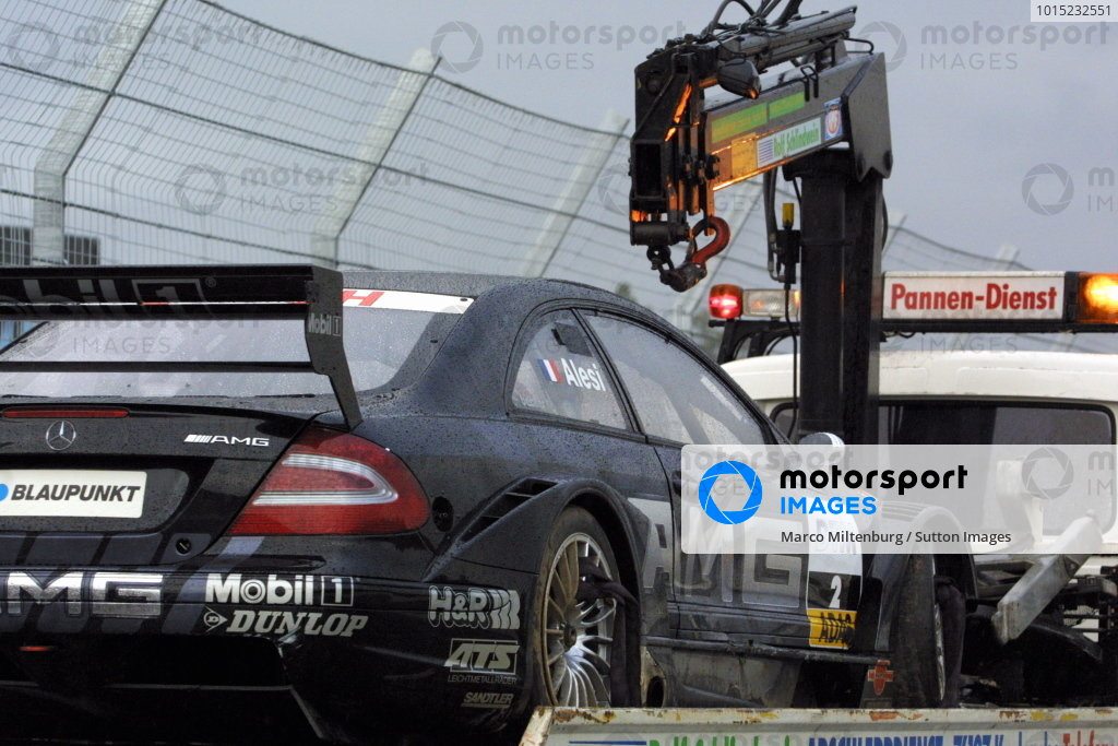 The damaged car of Jean Alesi (FRA), AMG-Mercedes CLK,  is taken away after a big shunt in the opening lap of the main race.DTM Championship, Rd10, Hockenheim, Germany. 06 October 2002.DIGITAL IMAGE