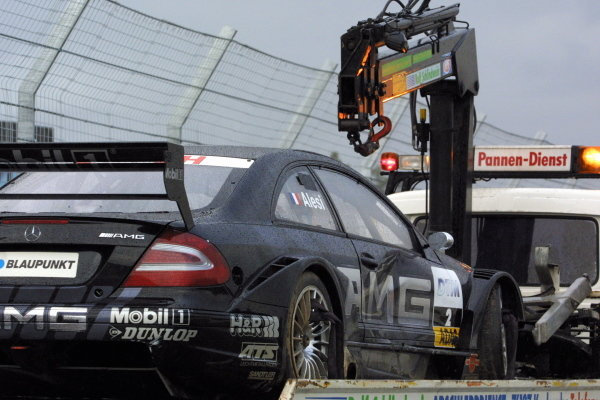 The damaged car of Jean Alesi (FRA), AMG-Mercedes CLK,  is taken away after a big shunt in the opening lap of the main race.