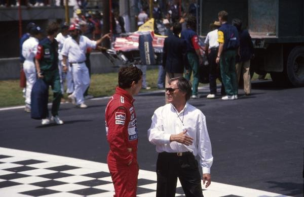 Ayrton Senna (BRA) McLaren MP4/4, 2nd place, chats with Bernie Ecclestone. Mexican Grand Prix, Mexico City, 29 May 1988