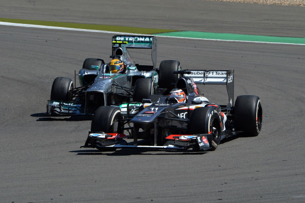 Lewis Hamilton (GBR) Mercedes AMG F1 W04 and Nico Hulkenberg (GER) Sauber C32 battle. Formula One World Championship, Rd9, German Grand Prix, Race Day, Nurburgring, Germany, Sunday 7 July 2013.