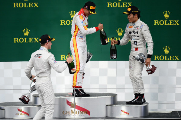 Race 2 podium (L to R): Second placed Stoffel Vandoorne (BEL) ART Grand Prix, race winner Rio Haryanto (INA) Trident and third placed Nobuharu Matsushita (JPN) ART Grand Prix celebrate on the podium with the champagne at GP2 Series, Rd4, Spielberg, Austria, 19-21 June 2015.