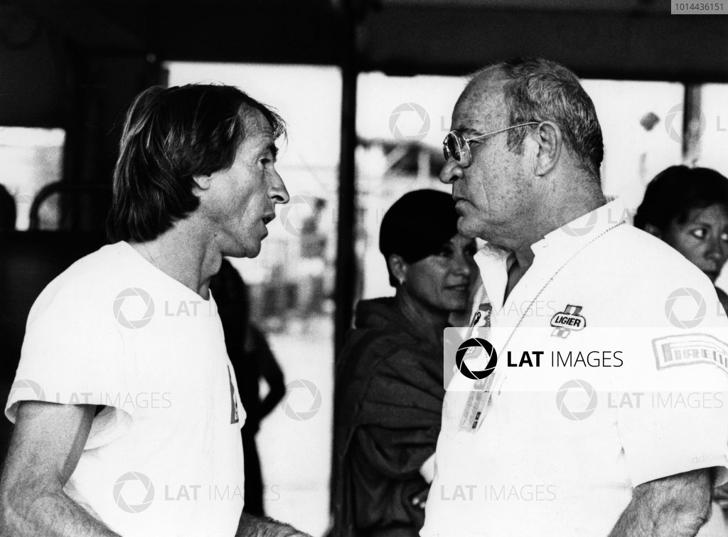1986 Formula One World Championship. Guy Ligier with Jacques Laffite in the pits, portrait.  World Copyright: LAT Photographic.  Ref: B/W Print.