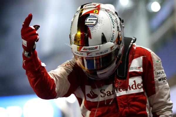 Marina Bay Circuit, Singapore. Sunday 20 September 2015. Sebastian Vettel, Ferrari, 1st Position, celebrates in Parc Ferme. World Copyright: Andrew Hone/LAT Photographic. ref: Digital Image _ONY8314