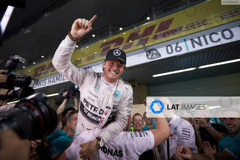 Yas Marina Circuit, Abu Dhabi, United Arab Emirates. Sunday 29 November 2015. Nico Rosberg, Mercedes AMG, 1st Position, and the Mercedes team celebrate victory. World Copyright: Steve Etherington/LAT Photographic ref: Digital Image SNE26856