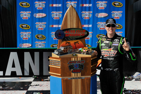 22-24 March 2013, Fontana, California USA Kyle Busch in victory lane with trophy ©2013, Scott R LePage LAT Photo USA