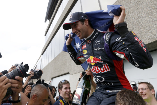 Circuit Gilles Villeneuve, Montreal, Canada. Sunday 8 June 2014. Daniel Ricciardo, Red Bull Racing, 1st Position, celebrates with his team. World Copyright: Alastair Staley/LAT Photographic. ref: Digital Image _79P1306