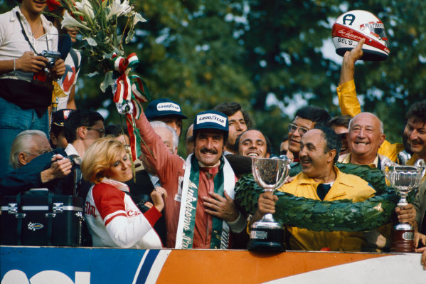 Monza, Italy. 5 - 7 September 1975.Clay Regazzoni (Ferrari 312T), 1st position, celebrates on the podium, portrait. World Copyright: LAT Photographic.Ref:  75ITA07.
