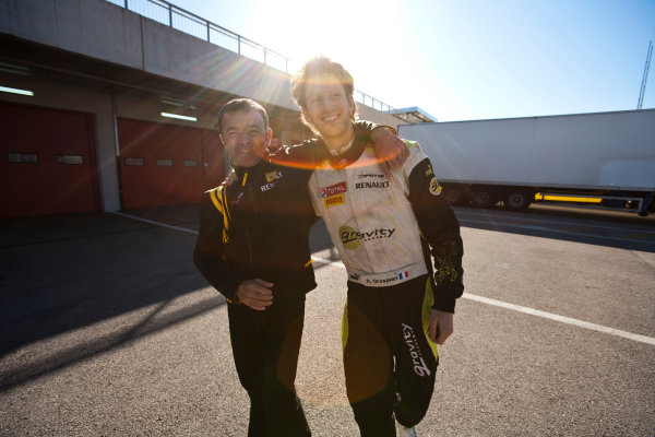 Imola, Italy. 20th March 2011. Sunday Race.Romain Grosjean, (FRA, Dams) celebrates victory in the Championship with Loic David, (team amnager).Portrait.   World Copyright: Drew Gibson/GP2 Media Service.ref: Digital Image _Y8P0612