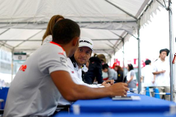 Suzuka Circuit, Suzuka, Japan.1st October 2009.Jenson Button, Brawn GP BGP001 Mercedes and Lewis Hamilton, McLaren MP4-24 Mercedes at the autograph signing session.World Copyright: Charles Coates/LAT Photographicref: Digital Image _26Y8577