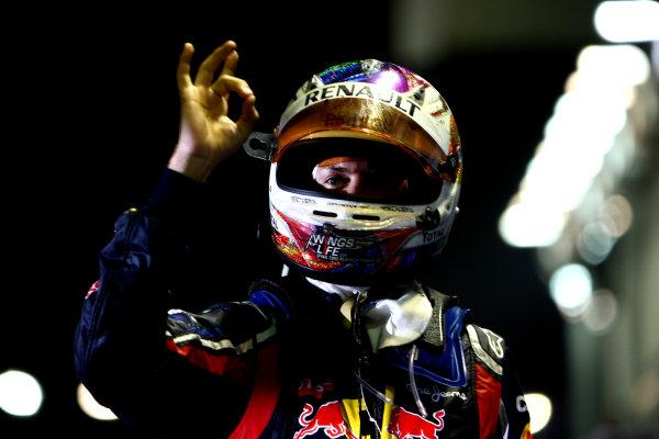 Marina Bay Circuit, Singapore.25th September 2011.Sebastian Vettel, Red Bull Racing RB7 Renault, 1st position, celebrates victory in Parc Ferme. Portrait. Helmets. Finish. World Copyright: Andy Hone/LAT Photographicref: Digital Image CSP28773