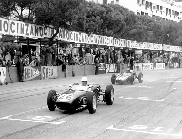 1960 Monaco Grand Prix. Monte Carlo, Monaco. 26th - 29th May 1960. John Surtees, Lotus 18-Climax, retired, makes his GP debut in front of Bruce McLaren, Cooper T53-Climax, 2nd position, action. World Copyright: LAT Photographic Ref: 21633 - 09.