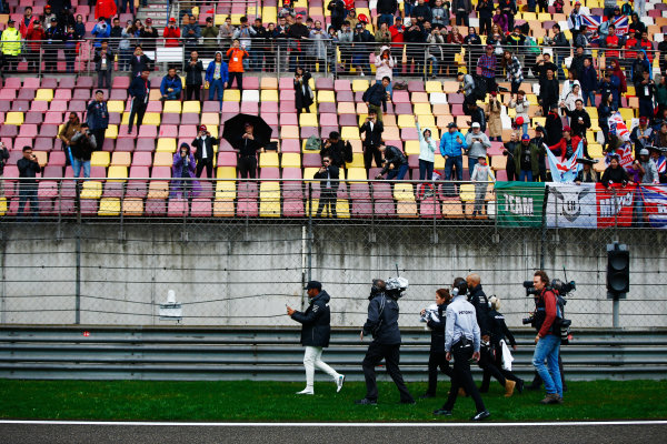 Shanghai International Circuit, Shanghai, China.  Friday 07 April 2017. Lewis Hamilton, Mercedes AMG, gives caps to fans during a weather delay in FP2. World World Copyright: Andy Hone/LAT Images ref: Digital Image _ONY4137