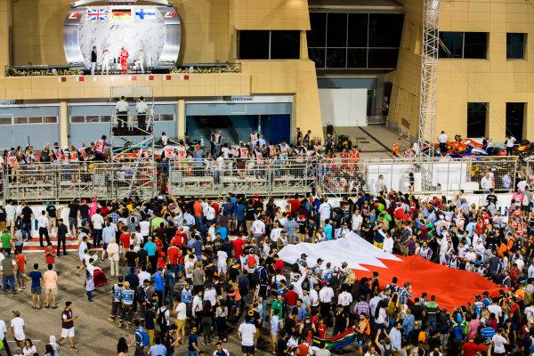 Bahrain International Circuit, Sakhir, Bahrain.  Sunday 16 April 2017. Fans join the podium celebrations after the race. World Copyright: Sam Bloxham/LAT Images ref: Digital Image _W6I3294