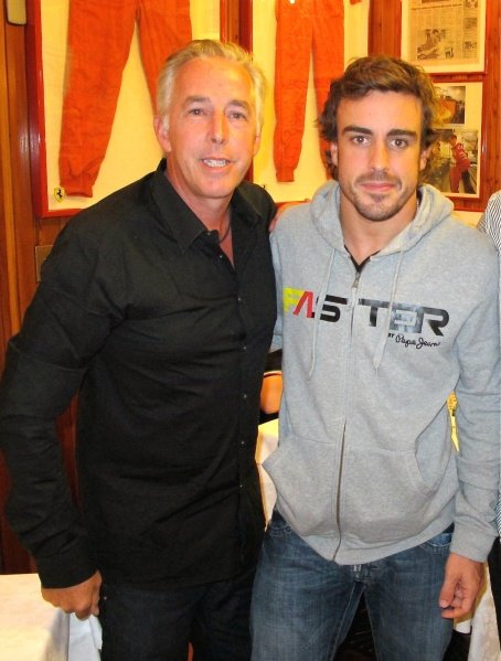 Keith Sutton (GBR) Sutton Images CEO and Fernando Alonso (ESP) Ferrari at the Montana Restaurant in Maranello.