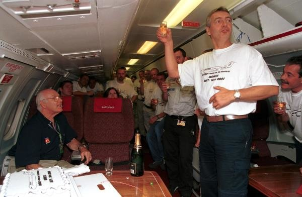 ITV Commentator Tony Jardine (Right) raises a toast for Murray Walker (left) aboard the European Aviation aeroplane after he commentated on his final European Grand Prix.  Italian Grand Prix, Monza, 16 September 2001