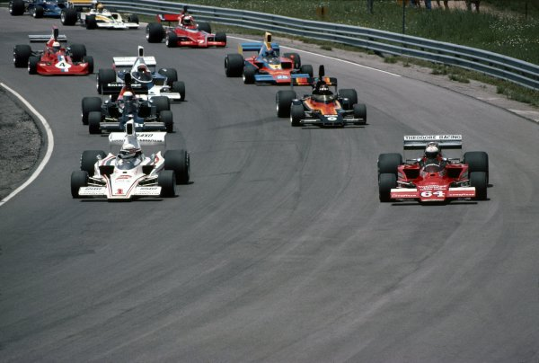 1976 SCCA/USAC F5000 Championship.Mosport Park, Ontario, Canada. 20th June 1976.Brian Redman, Lola T332C, leads eventual winner, Alan Jones, Lola T332, Danny Ongais, Lola T332 and Jackie Oliver, Shadow DN6B, around at the start of the race, action.World Copyright: LAT Photographic.