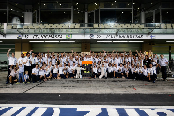 Yas Marina Circuit, Abu Dhabi, United Arab Emirates. Sunday 23 November 2014. The Williams team celebrate securing third in the Constructors Championship. World Copyright: Glenn Dunbar/LAT Photographic. ref: Digital Image _W2Q7488