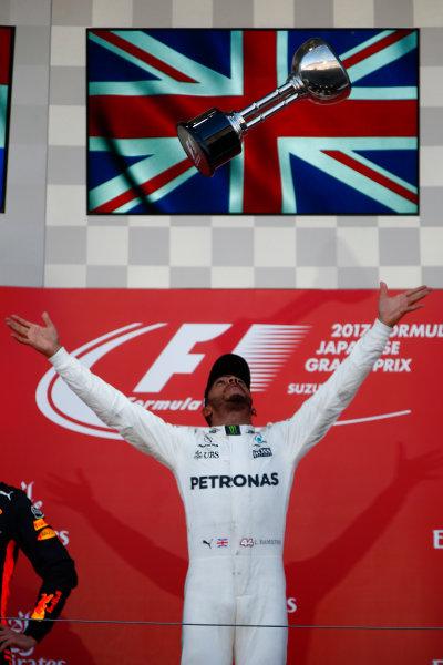 Suzuka Circuit, Japan. Sunday 8 October 2017. Lewis Hamilton, Mercedes AMG, 1st Position, celebrates with his trophy. World Copyright: Andrew Hone/LAT Images  ref: Digital Image _ONY8759