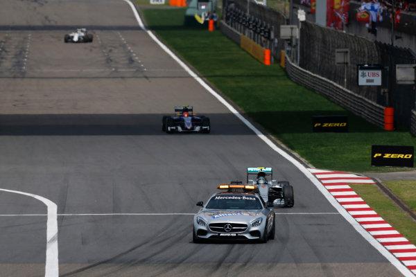 Shanghai International Circuit, Shanghai, China. Sunday 17 April 2016. Nico Rosberg, Mercedes F1 W07 Hybrid leads the race behind the Safety Car. World Copyright: Sam Bloxham/LAT Photographic ref: Digital Image _R6T1146