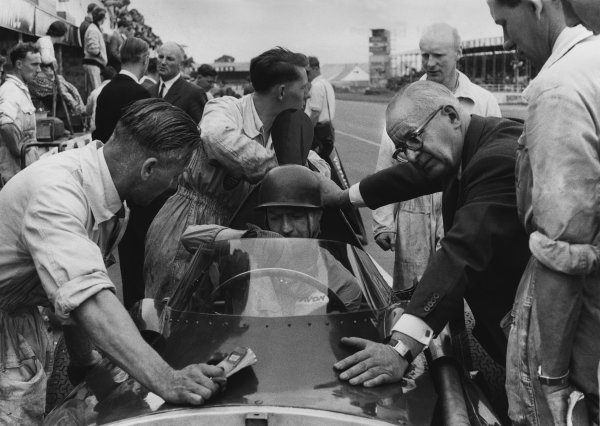 Silverstone, England. 17th - 19th July 1958.Tony Brooks (Vanwall VW5) 7th position, in the pits before the race with Tony Vandervell, portrait. World Copyright: LAT Photographic.Ref:  7972A - 16.