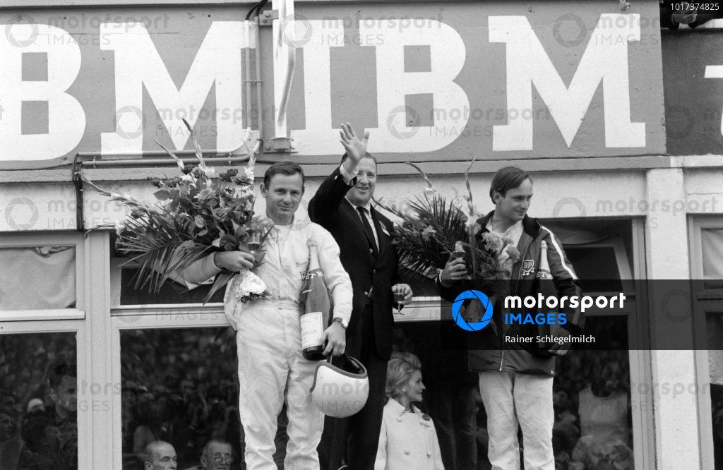 Bruce McLaren and Chris Amon, 1st position, on the podium with Henry Ford II.