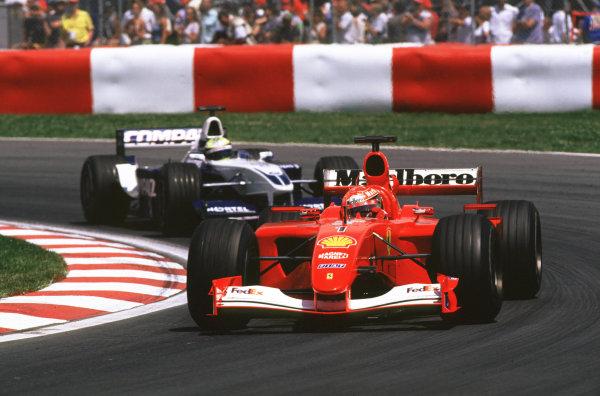 2001 Canadian Grand PrixMontreal, Canada. 8th-10th June 2001Michael Schumacher, Ferrari F2001, leads race winner Ralf Schumacher, BMW Williams FW23, action.World Copyright: LAT Photographicref: 35mm Image A07