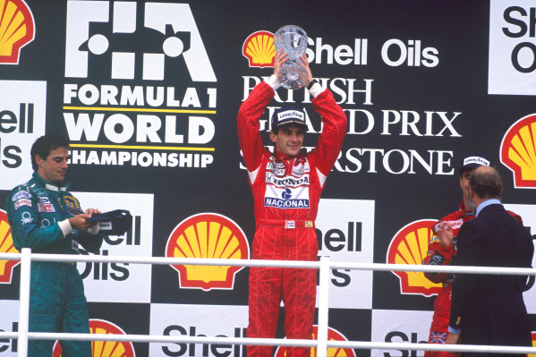 Silverstone, England. 8th - 10th July 1988.Ayrton Senna (McLaren MP4/4 Honda), 1st position with  Nigel Mansell (Williams Judd) 2nd position and Alessandro Nannini (Benetton Ford) 3rd position celebrate on the podium. World Copyright - LAT Photographic.Ref: 88GB21.
