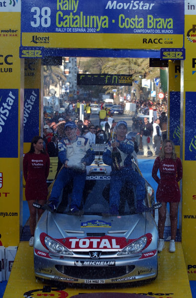 2002 World Rally ChampionshipRally Catalunya, 21st-24th March 2002.Gilles and Herve Panizzi spray the victory champagne. Photo: Ralph Hardwick/LAT