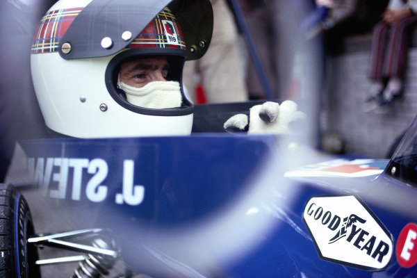 Jackie Stewart, seen in the mirror of his Tyrrell 003 Ford.