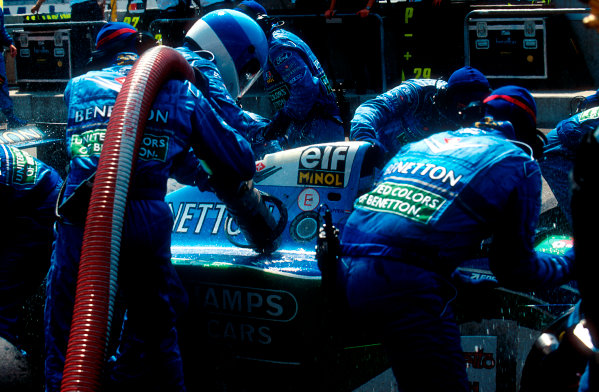 1994 German Grand Prix.Hockenheim, Germany.29-31 July 1994.Jos Verstappen (Benetton B194 Ford) comes in for his pitstop. As the Refueller pulls the fuel hose away the valve sticks open allowing fuel to still come out of the nozzle and over the car.Ref-94 GER 04.World Copyright - LAT Photographic