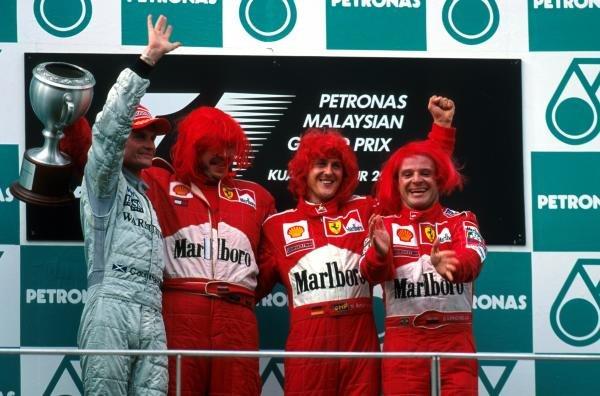 From left to right: David Coulthard(GBR)McLaren Mercedes MP4-15, 2nd, Ross Brawn, Winner Michael Schumacher(GER)Ferrari F1-2000 and third placed Rubens Barrichello(BRA)Ferrari F1-2000 Malaysian GP, Sepang, 22 October 2000