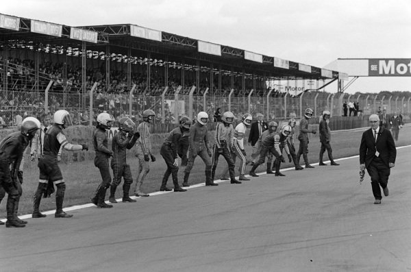 Riders get ready for the Le Mans start of the 250 class production bike race.
