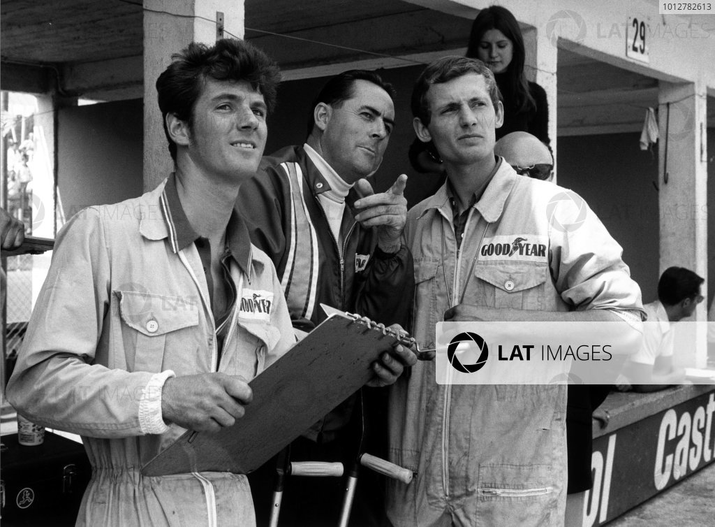 2003 Racing Past. . Exhibition51. 1969 German Grand Prix, Nurburgring. A youthful Ron Dennis in conversation with team owner Jack Brabham.World Copyright - LAT PhotographicExhibition ref: a051