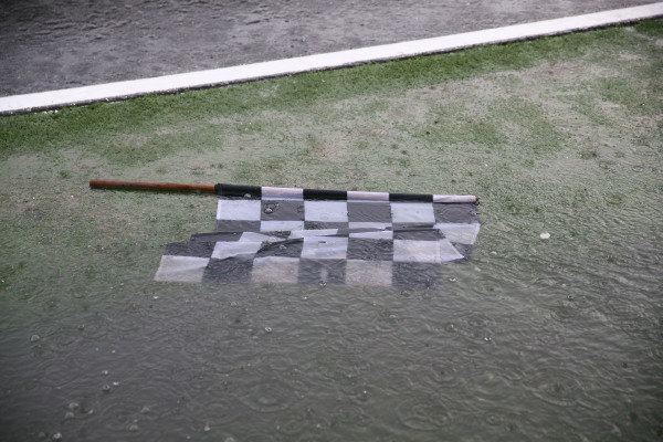 Chequered flag and rain.