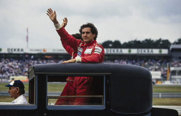 Ayrton Senna and Michael Andretti wave to the crowd on the drivers parade lap.