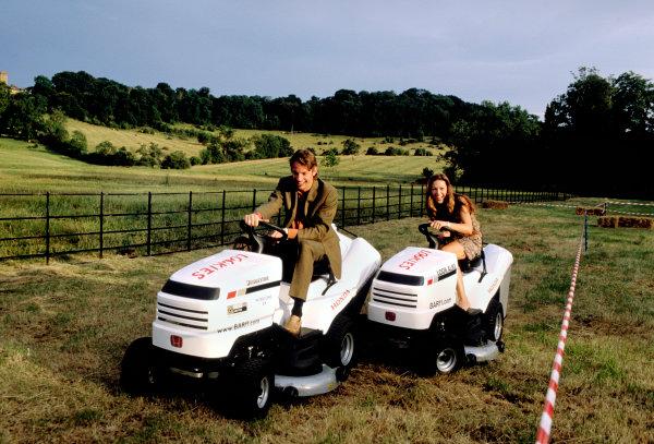 2003 British Grand PrixSilverstone, England. 18th - 20th July 2003.Jenson Button, BAR Honda 005, and girlfriend on Honda lawnmowers.World Copyright: Steven Tee / LAT Photographic ref: 35mm Image 03GB34