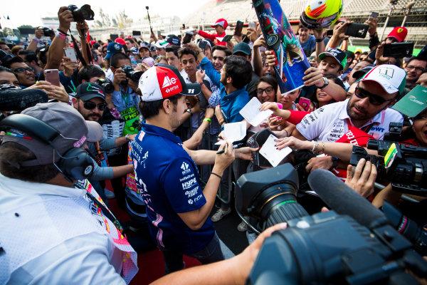 Autodromo Hermanos Rodriguez, Mexico City, Mexico. Thursday 26 October 2017. Sergio Perez, Force India, signs autographs for fans. World Copyright: Sam Bloxham/LAT Images  ref: Digital Image _W6I9246