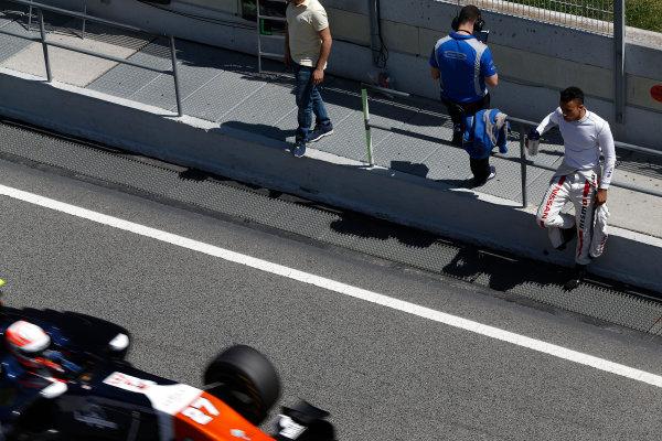 2015 GP3 Series Test 3 - Circuit de Catalunya, Barcelona, Spain. Thursday 23 April 2015. Jann Mardenborough, (GBR, Carlin), watches Luca Ghiotto (ITA, Trident) pass in the pit lane Photo: Sam Bloxham/GP3 Series Media Service. ref: Digital Image _SBL1821
