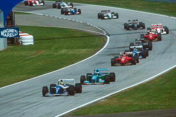 Imola, Italy.29/4-1/5 1994.Ayrton Senna (Williams FW16 Renault) leads Michael Schumacher (Benetton B194 Ford), Gerhard Berger (Ferrari 412T1), Damon Hill (Williams FW16 Renault), Heinz-Harald Frentzen (Sauber C13 Ford), Nicola Larini (Ferrari 412T1), Mika Hakkinen (McLaren MP4/9 Peugeot) and Karl Wendlinger (Sauber C13 Ford) at the start.Ref-94 SM 06.World Copyright - LAT Photographic