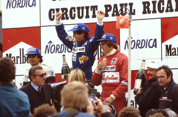 Paul Ricard, France.15-17 April 1983.Alain Prost (Equipe Renault) 1st position, Nelson Piquet (Brabham BMW) 2nd position and Eddie Cheever (Equipe Renault) 3rd position on the podium. With FIA President Jean-Marie Balestre in front of them.Ref-83 FRA 02.World Copyright - LAT Photographic