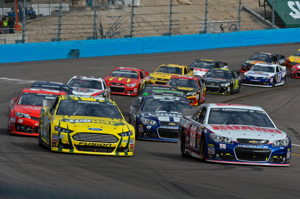 March 1-3, 2013 Avondale, Arizona USA Dale Earnhardt Jr and Carl Edwards restart.(c) 2013, Brian Czobat LAT Photo USA .