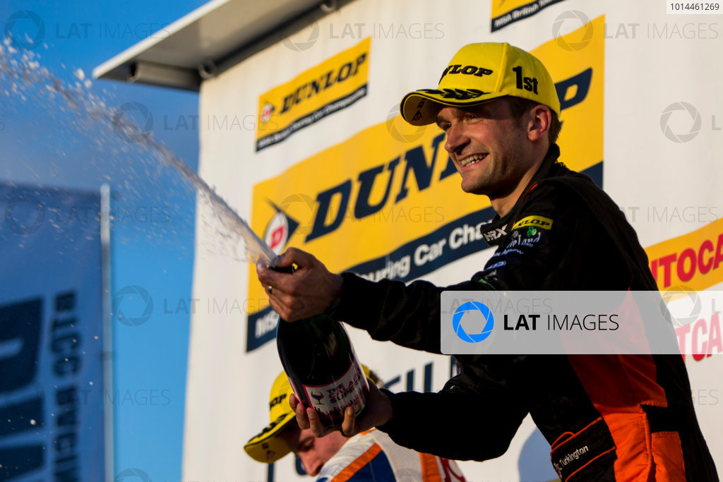 2015 British Touring Car Championship, Silverstone, Northamptonshire, England. 26th - 27th September 2015. Colin Turkington (GBR) Team BMR Volkswagen Passat CC, 1st position, on the podium. World Copyright: Zak Mauger/LAT Photographic. ref: Digital Image _L0U4858