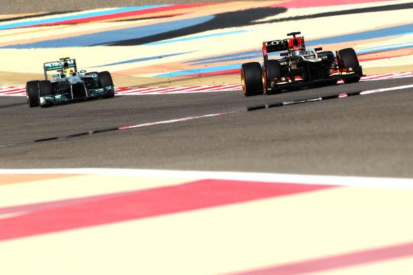 Bahrain International Circuit, Sakhir, Bahrain Sunday 21st April 2013 Kimi Raikkonen, Lotus E21 Renault, leads Lewis Hamilton, Mercedes W04.  World Copyright: Andy Hone/LAT Photographic ref: Digital Image HONY1228